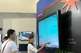A Samsung booth hostess showed off one of the company's multitouch E-boards at this year's Shanghai show.