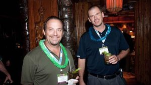 Tom Townsend, president and CEO of Scooter's Coffeehouse, enjoys a mai tai with Scooter's chief financial officer Todd Graeve.