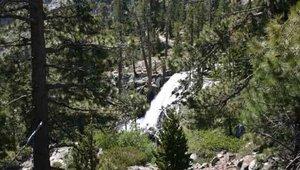 A waterfall feeds into California's Emerald Bay.