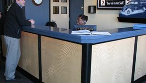 The lobby at White Castle company headquarters was recently remodeled. Jamie Richardson, VP of government and shareholder relations for White Castle, greets the receptionist.