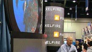 A NanoLumens spokesman shakes one of the company's displays to show its flexibility.