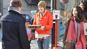 Pie Face Employee Meg Smith passes out samples of hot chocolate on a cold NYC day.