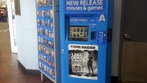 A Redbox DVD-rental kiosk located in the entry of Walmart.