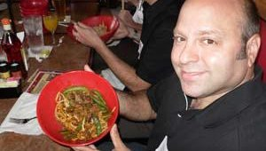 Darren Tristano, executive vice president of Chicago-based Technomic, shows off his Mongo BBQ bowl. The menu item features marinated beef, citrus garlic herbs, Mongo mix, Mongo BBQ sauce and steamed rice. Tristano ordered his with Udon Noodles&#46
