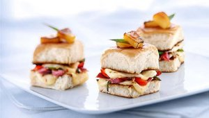 Melthouse Bistro's menu was modeled after the Wisconsin Milk Marketing Board's Grilled Cheese Academy website. The Lil' Kahuna is four morsels of Wisconsin Pepper Jack, pineapple, sautéed bell peppers and smoked ham on a Country Buttertop Bun.