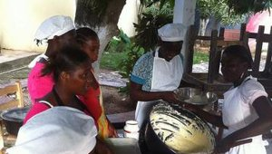 The women of Jacmel's Organisation Tendre Enfance bake a cake for the Chefs4Kids team on their first day in Haiti.