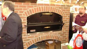 Marsal's brick enclosures, on display at the show, give deck ovens the feel of a stone hearth oven. Operators are increasingly positioning ovens as a source of entertainment for customers.
