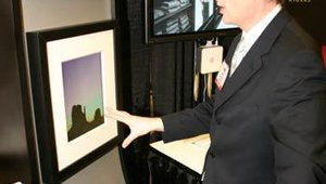 "Nanonation's booth was decked with some head-turning ""picture frames"" that were built around slim digital displays, allowing the dynamic updating of artwork."