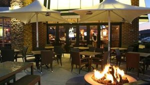 """Exterior upgrades include patio-style seating and a more sophisticated design. The changes are all about """"building sales, legendary service and food, market penetration and bringing the brand back to its former stature,"""" said CEO Paul Mangiamele."""