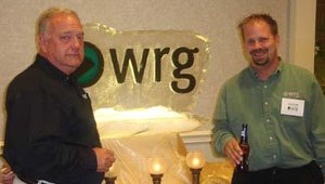 WRG CEO Mike Stevenson, left, and vice president of operations Jason Kuhn, welcome distributors Sept. 20 during the distributors' conference opening reception.