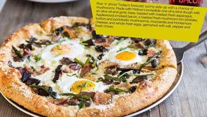 Mellow Mushroom's Wake-n-Bacon, a pizza with asparagus and Applewood smoked bacon and a mushroom trio.