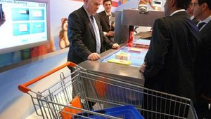 Assisted automated checkout is demonstrated by Josef Twiste.