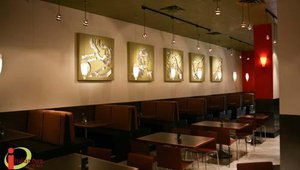 The Italian Oven Cafe's interior features warm tones of red, tan and brown, and a variety of seating options. The restaurant's first concept development location was opened in Pittsburgh more than four years ago.