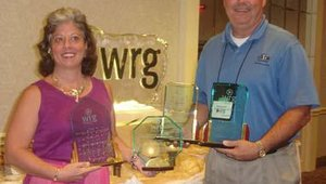 Jeff Munford of ATM Central took four awards, including the Distributor of the Year, home from the conference. After the nonors, Munford and his wife Barb Scion, smiled for the cameras.
