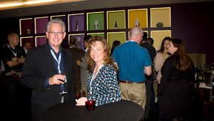 Kirk Michelson from sponsor Service Management Group enjoyed the complimentary drinks with Lori Walderich from Idea Studio.