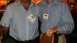 Demetris Havadjias (left), Farmer Boys, and Alan Hixon, Freebirds World Burrito, get reaquainted during the Summit networking reception.