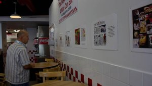 Part of the food tour included trivia questions for each of the restaurants. At Five Guys Burgers & Fries, print clippings from stories about the chain provided helpful information.