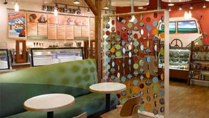"To reinforce Ben & Jerry's pint ice cream, Tesser created a ""flavor curtain,"" using actual pint lids as a design element. The lids mimic the free-spirited chic appeal reminiscent of the beaded curtains that were popular in the 1970s&#4"