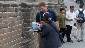 haggled with a bookseller on top of the Great Wall.