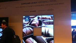<p>Four Samsung panels in a unique shape displaying content in concert.</p>