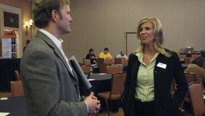 From left are Mike Urban, senior director of fraud solutions for FICO (formerly Fair Isaac Corp.), and Terrie Ipson of Diebold.