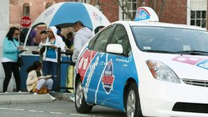 A New Bedford, Mass., Domino's Pizza franchisee, Nelson Hockert-Lotz, uses two hybrid vehicles in his fleet of delivery vehicles.