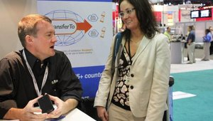 """James Wester, editor of MobilePaymentsToday.com, chats with Sarah Amitay of Mobext Mobile Marketing about the future of mobile payments. Wester spent some time at the booth for a """"meet the editor session."""""""