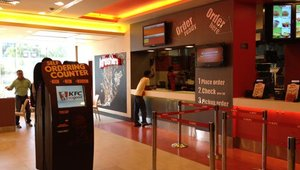 The self-order station in the lobby of an Indian KFC franchise. The kiosks are tailored to appeal to the country's tech-friendly middle class.