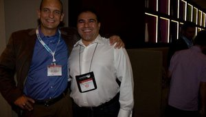 Bobby Renaud, with FastCasual.com, showed appreciation to Mo Asgari. Mo is with Platinum sponsor MonkeyMedia.