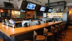 """The outdated sports memorabilia has been replaced by sophisticated wood paneling. CEO Paul Mangiamele said he wants to create """"the unchained chain"""" to appeal to more neighborhood diners."""