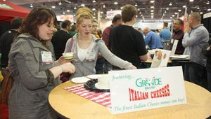 Alyssa Davis and LeeAnn Greitzer sample ricotta cheese from Grande.