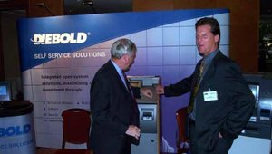 Diebold's Graham McKay (left) and Andrew Knight of Triage caught in a candid shot in the Diebold booth.