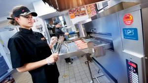 The Duke batch broiler cooks up to eight Whopper patties at one time. Control features cycle the burners on and off and at varying percentages during the cooking cycle to allow Burger King to offer virtually any menu item.