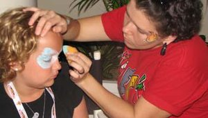 Activities at the welcome picnic included a face painter for children.