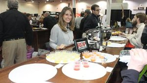 Darcy Gilmer with RDP Foodservice debuted a slew of new sauces at the North American Pizza and Ice Cream Show in Columbus, Ohio, Feb. 21, 2010.