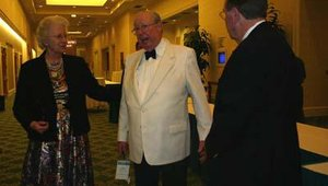 Shepherd-Barron and his wife Caroline met with conference attendees before the annual awards banquet. Above, the couple talk with Alan Fryrear, chairman of Louisville, Ky.-based NetWorld Alliance, ATM Marketplace's parent.