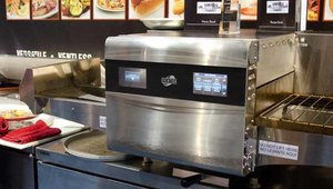 Ovention Inc.'s Ovention Matchbox is an intelligent, self-loading and unloading oven design that uses two alternating cook surfaces using impingement only. It doesn't require a hood and enables food items to be cooked one after another at temperatures that vary by up to 100 degrees.
