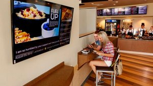 A digital queue in Kitchen 67 gives visitors waiting for service at Verizon the flexibility to grab food while keeping their place in line; they're notified via digital screen in the restaurant when it's their turn.