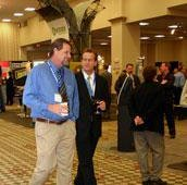 A couple of attendees enjoyed the amenities while strolling by the booth of anchor partner KIOSK Information Systems.