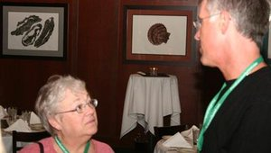 Mary Jo Beniger from Osteria Nonna Maria in Sheboygan, Wis., talks with Sean Cummins from Uncle Dan's Pizza & Pub in Park Ridge, Ill.