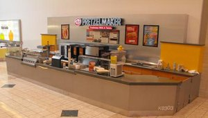 This newly branded Pretzelmaker store is an example of an airport location and features some of the new color scheme.