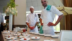 Wildwood restaurant executive chef Dustin Clark (right) and his assistant served his flavor-filled entrée to guests.