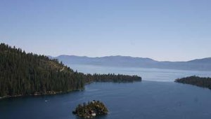 Lake Tahoe's Emerald Bay in California, one of the most photographed locations in the world, according to roadside signs. In the foreground, a small island with Vikingsholm Castle, built as a summer home in 1929 by Laura Josephine Knight.