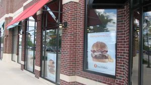 The Yorktown Center location has several signs in the window announcing the arrival of Tom & Eddie's. The gourmet burger concept will feature menu items such as The Blue Chip, Baby Bella & Swiss, and a hot dog called Windy City Jamaican.
