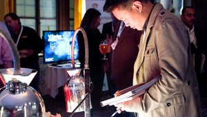 Peter Yen, founder of Sushirrito, eyes a table of food items created by Summit Gold sponsor Truitt Bros.