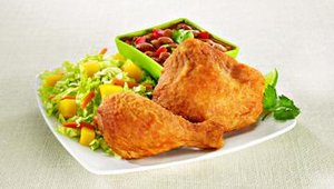 The two-piece fried chicken meal includes a leg and thigh, a side and  a choice of tortillas, dinner roll or biscuit.