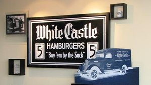 """White Castle's first slogan, """"Buy 'em by the Sack,"""" was coined in the 1920s. The current slogan, """"White Castle, What You Crave,"""" was put in use in 1993 and plays up the brand's cult-like following."""
