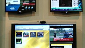ONELAN displayed its Net-Top-Box multizoned solution capable of displaying stored and live media, web pages and broadcast TV.