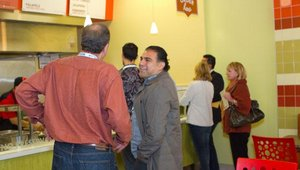 Larry Reinstein from Salsarita's (left) and Mo Asgari of MonkeyMedia Software (right) decide which menu items to order from I Dream of Falafel during the 2011 Fast Casual Executive Summit food tour.