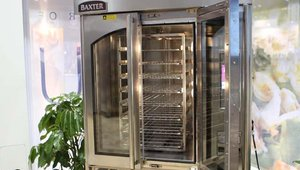 Hobart's Baxter Mini Rotating Rack Oven features the company's patented self-contained spherical cast steam system. The steam combines with the Baxter airflow system to provide even heat dispersion throughout the oven, providing an even bake.